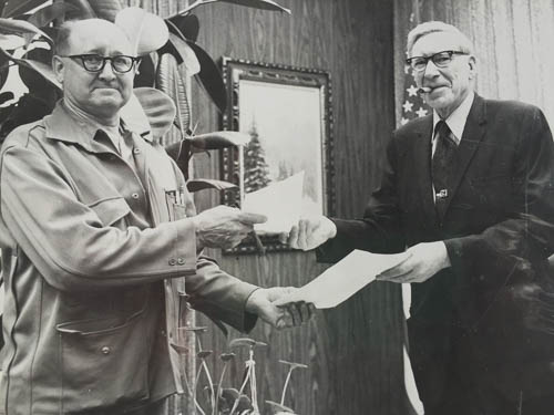 Arnold Muldoon, left, with Greater Anchorage Area Borough Mayor John Asplund, after the last of his homestead was sold to the Borough for less than half its appraised value; it is now Arnold L. Muldoon Park.